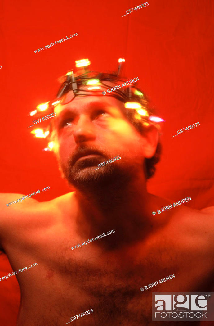 Stock Photo: Man with crown of lights.