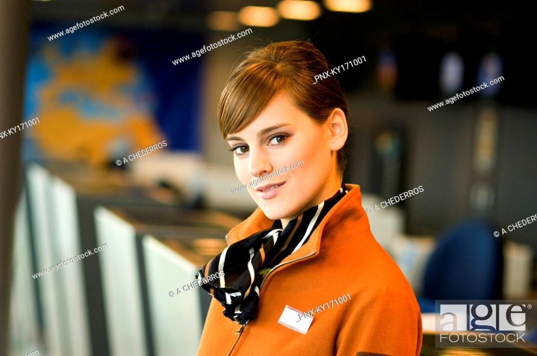 Stock Photo: Portrait of a female airline check-in attendant.