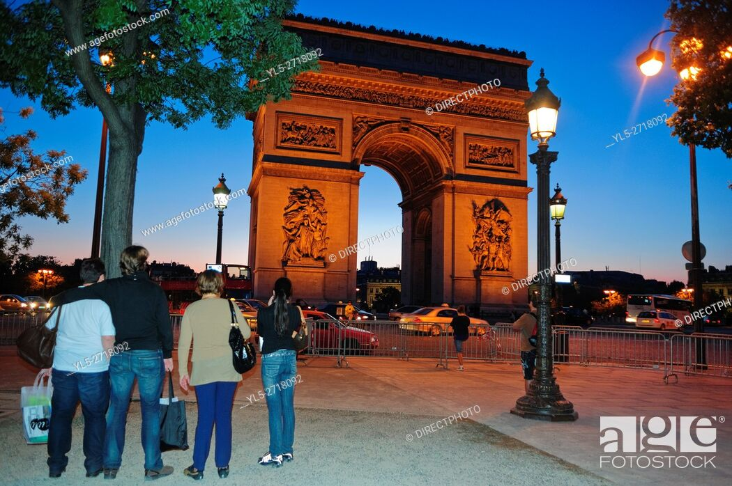 Stock Photo: Paris, France, Street Scene, Group of Tourists, Visiting, the Arc de Triomphe Monument on the Ave. Champs Elysees, lit up at Night.