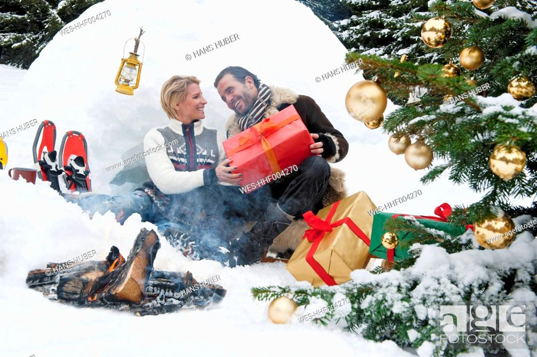 Stock Photo: Austria, Salzburg County, Couple celebrating christmas in nature, smiling.