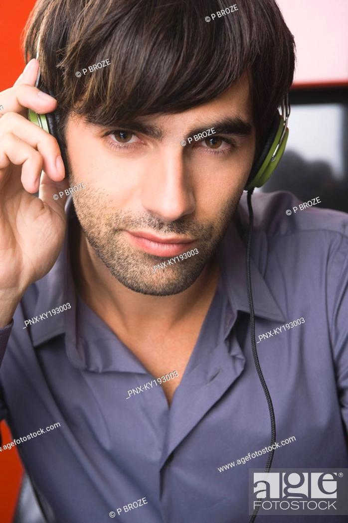 Stock Photo: Portrait of a man listening to headphones.