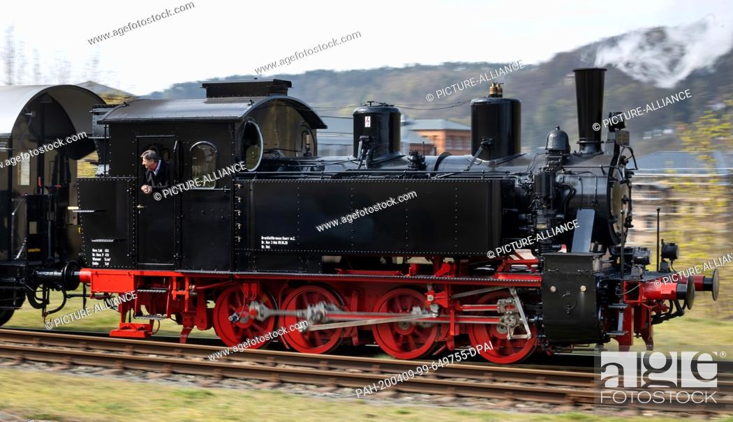 Stock Photo: 09 April 2020, Thuringia, Meiningen: The newly repaired steam locomotive 99 886 of the Rhön train, which was severely damaged in an accident in summer 2018.