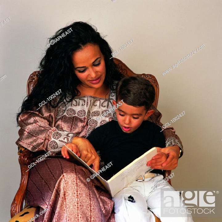 Stock Photo: Mother and son reading a book.