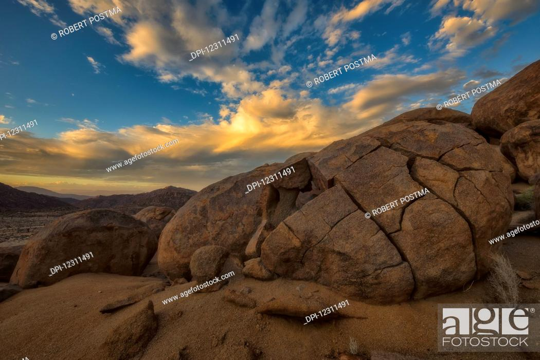 Stock Photo: Sunset over the large rounded boulders in Richtersveld National Park; South Africa.