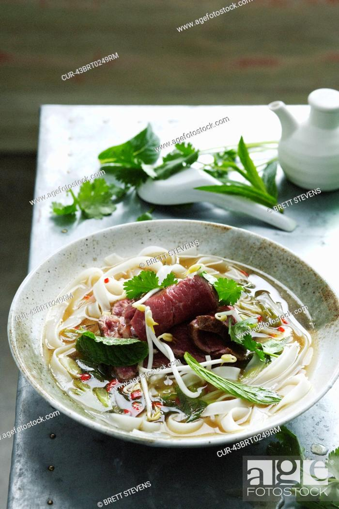 Stock Photo: Bowl of pho soup with noodles.