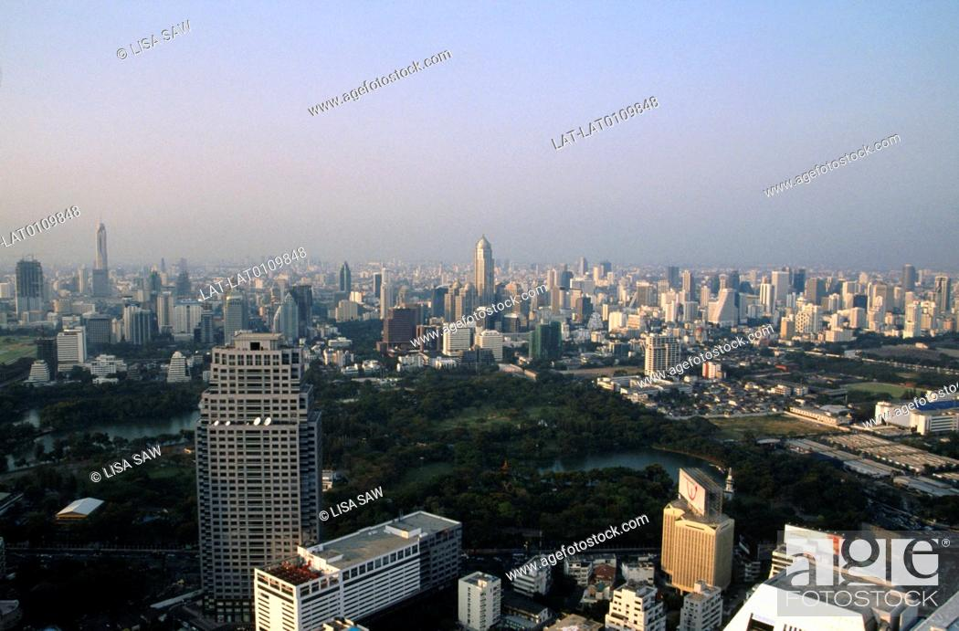 Stock Photo: Citiscape from the Banyan Tree Hotel over the city,with Lumphini park and the lake. Air polllution creating a haze.
