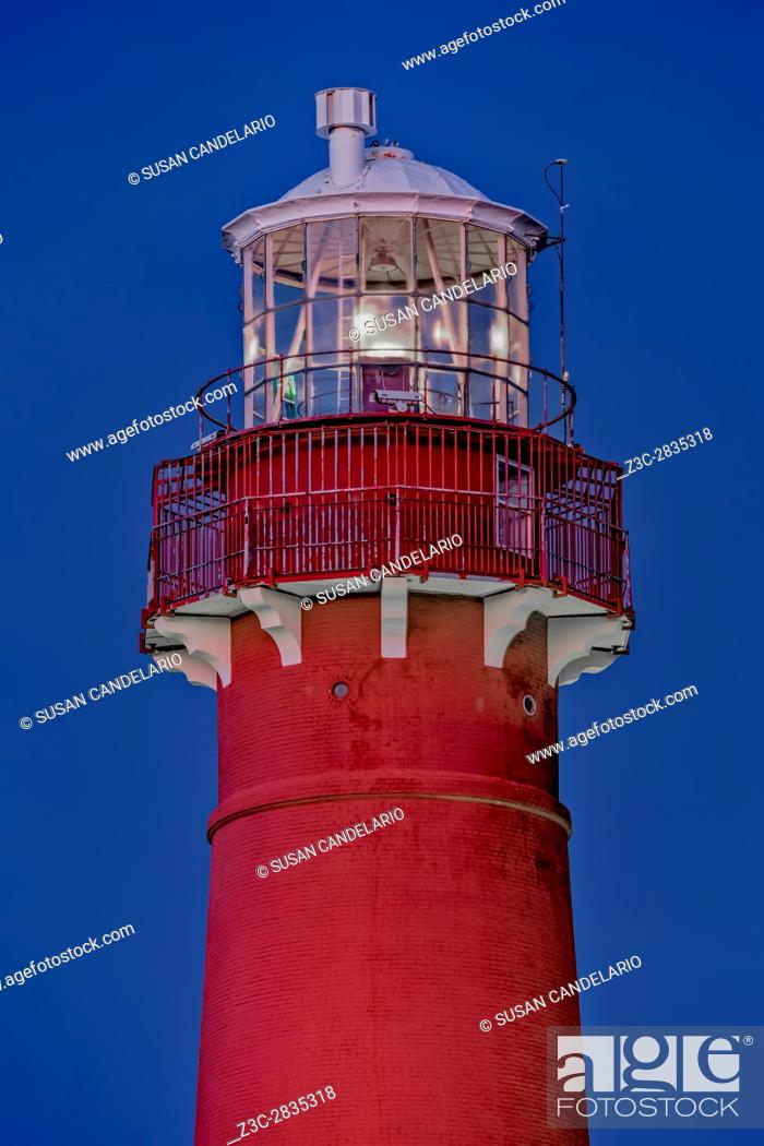"""Stock Photo: Barnegat Lighthouse - Close view to the tip of Barnegat Lighthouse or Barnegat Light, colloquially known as """"""""Old Barney""""""""."""