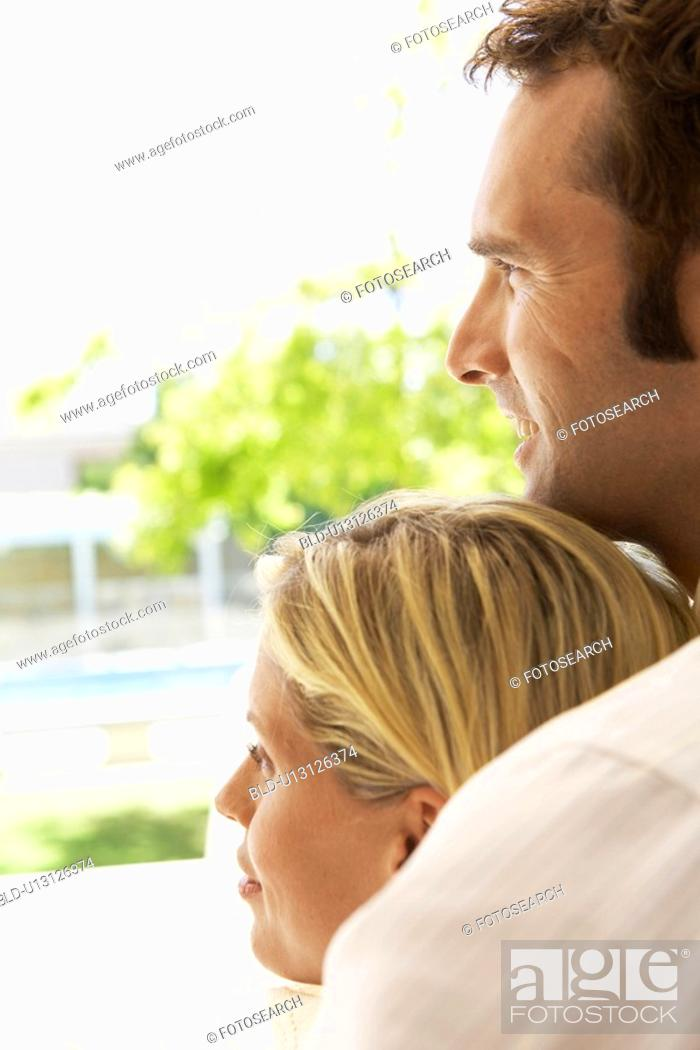 Stock Photo: Mid adult couple looking at view.