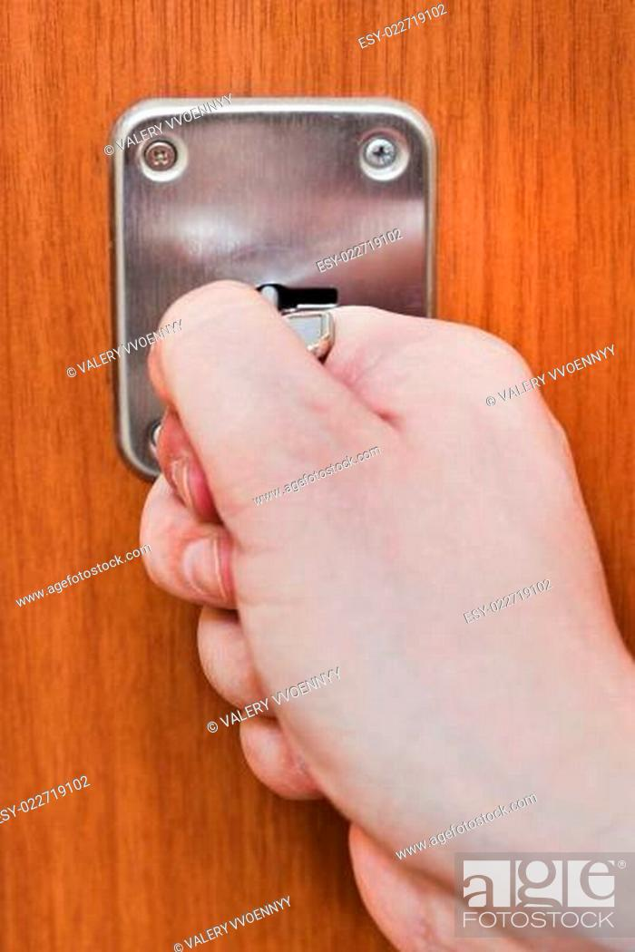 Photo de stock: opening home door by key.