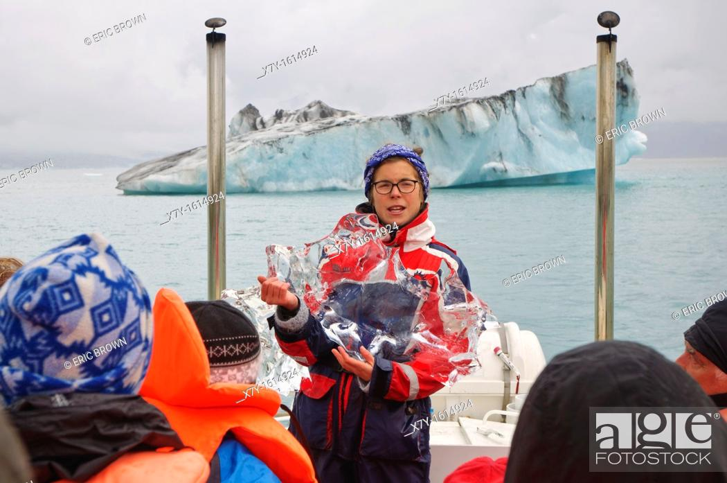 Stock Photo: A guide explains glacial ice onboard a tour of Glacier Lagoon, Iceland.