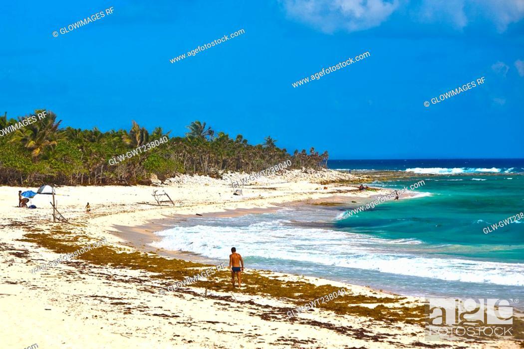 Stock Photo: Tourist on the beach, Tulum, Quintan Roo, Mexico.