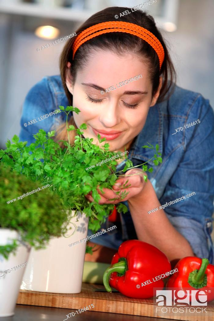 Stock Photo: woman cooking with fresh spices.