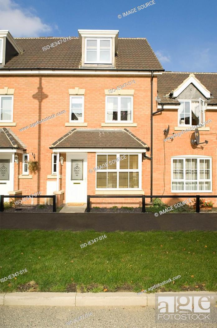 Stock Photo: Houses on a street.