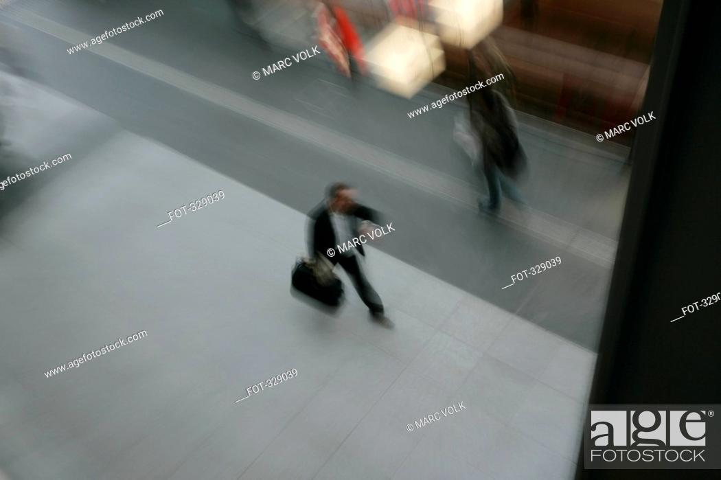 Stock Photo: Commuter walking along platform at train station.