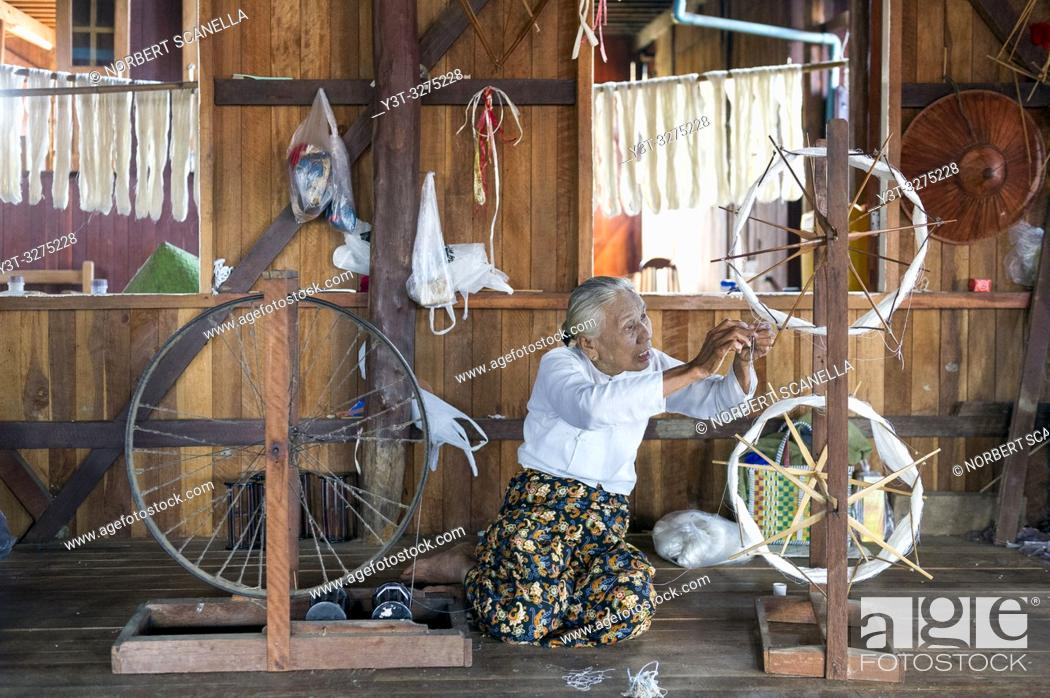 Stock Photo: Myanmar (ex Birmanie). Inle lake. Shan state. The Intha, an ethnic group of Inle Lake, live in about 40 lake villages around the lake. Weaving work.