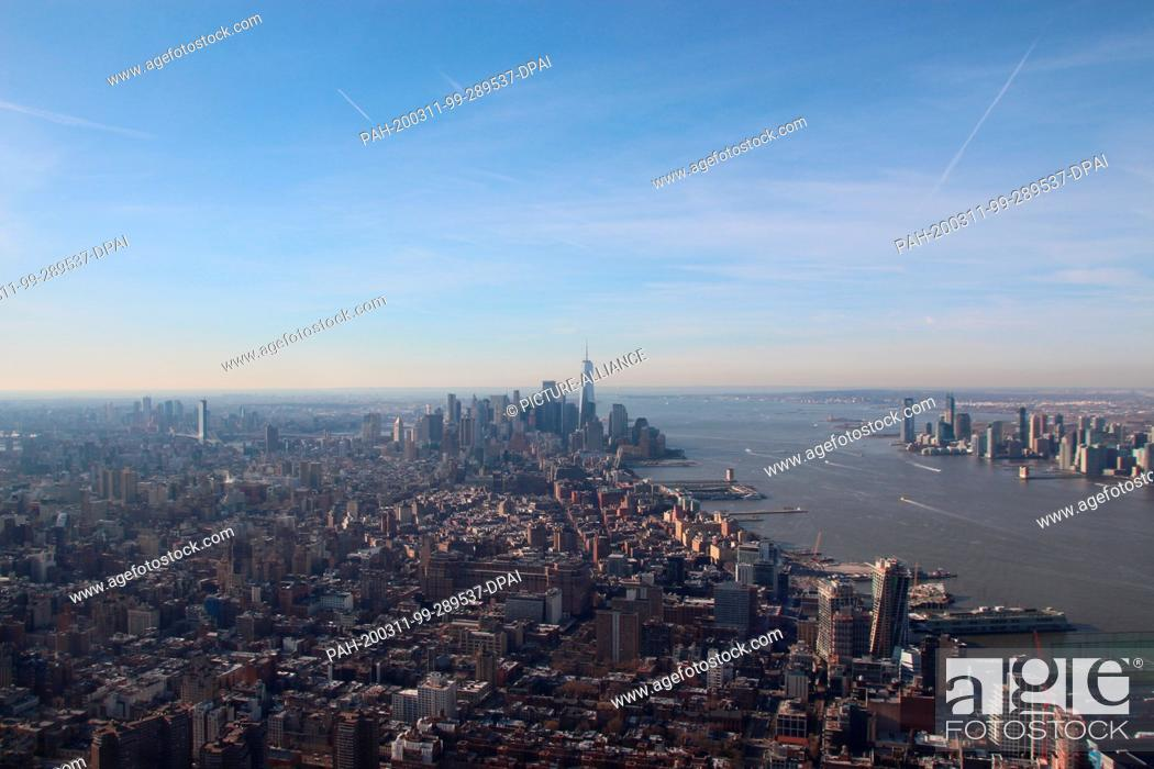 Stock Photo: 11 March 2020, US, New York: New York panorama from the new triangular viewing platform Edge. The platform is in one of the new skyscrapers in the Hudson Yards.