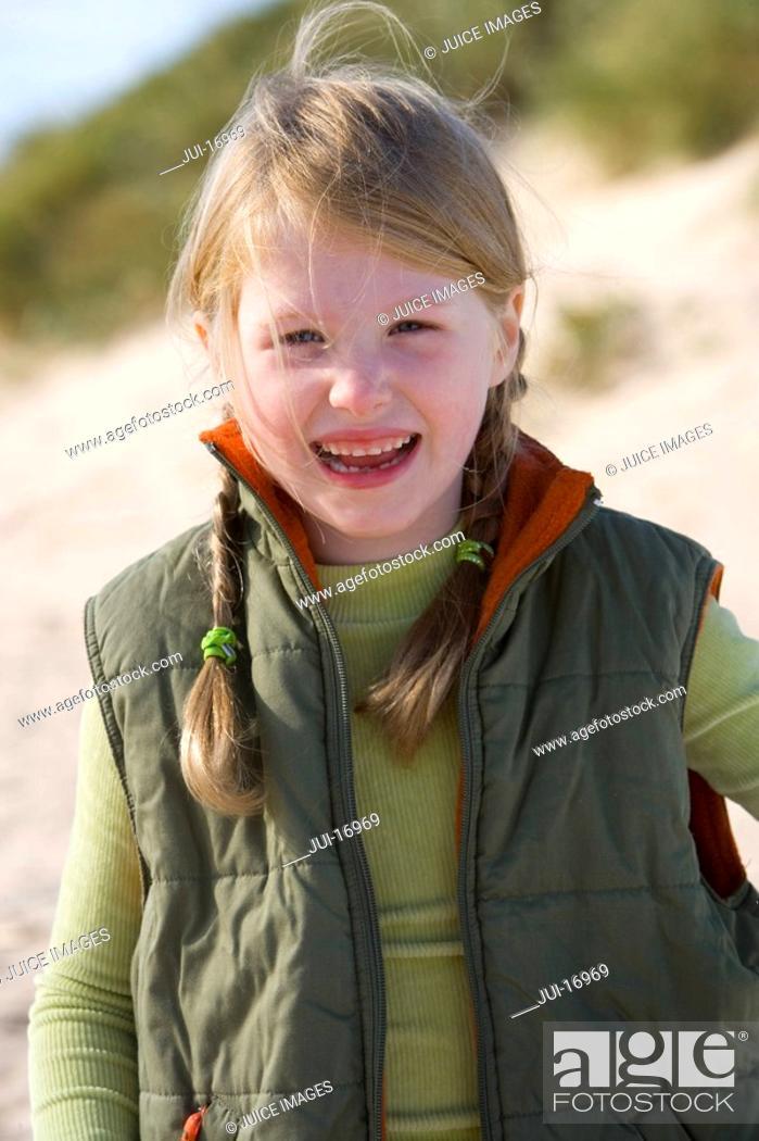 Stock Photo: Portrait of girl standing on beach.