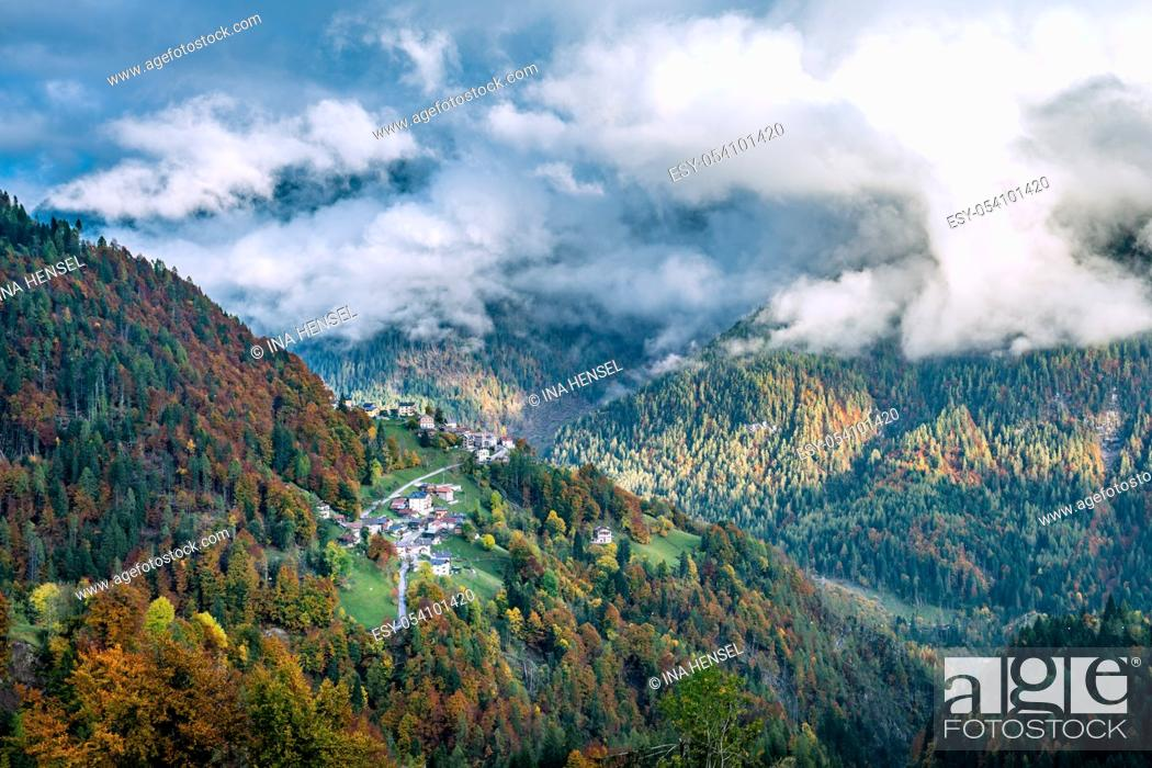 Stock Photo: Colourful aumtumn view across the Cordevole valley with Pecol and Piaia villages in the background in Belluno, Italy.