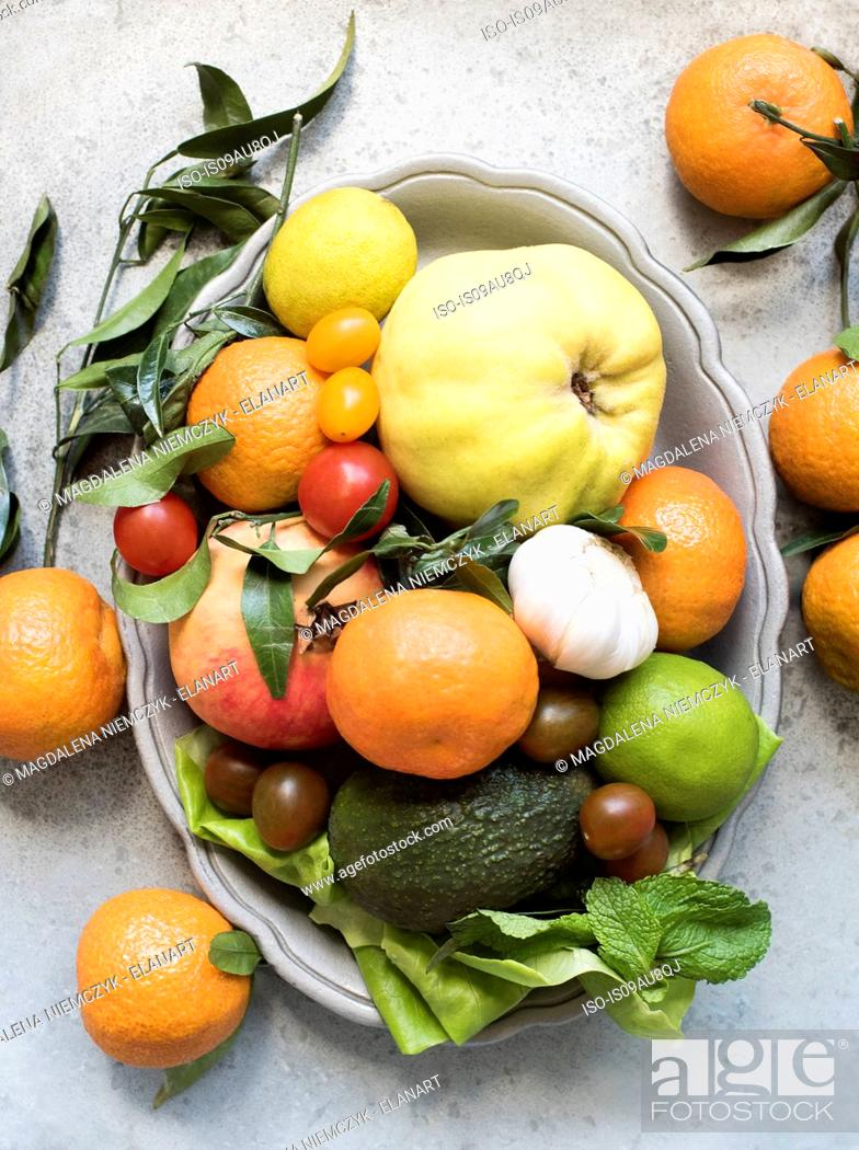 Stock Photo: Overhead view of colourful fruit and vegetables in serving dish.