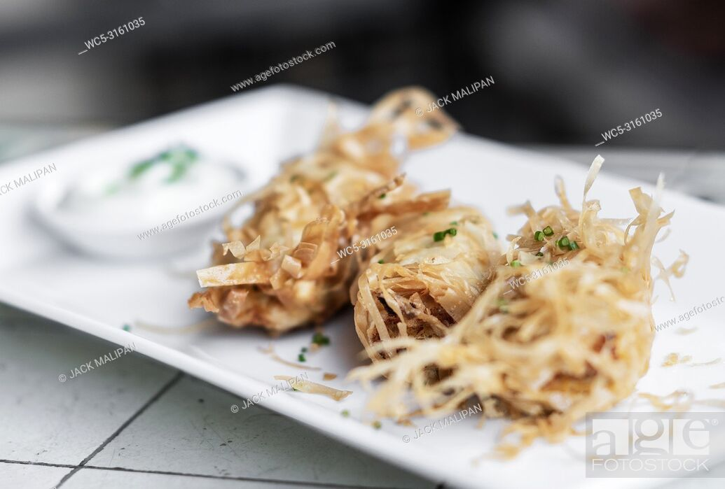 Stock Photo: asian fried rice noodle shrimp spring rolls starter dish in Singapore.