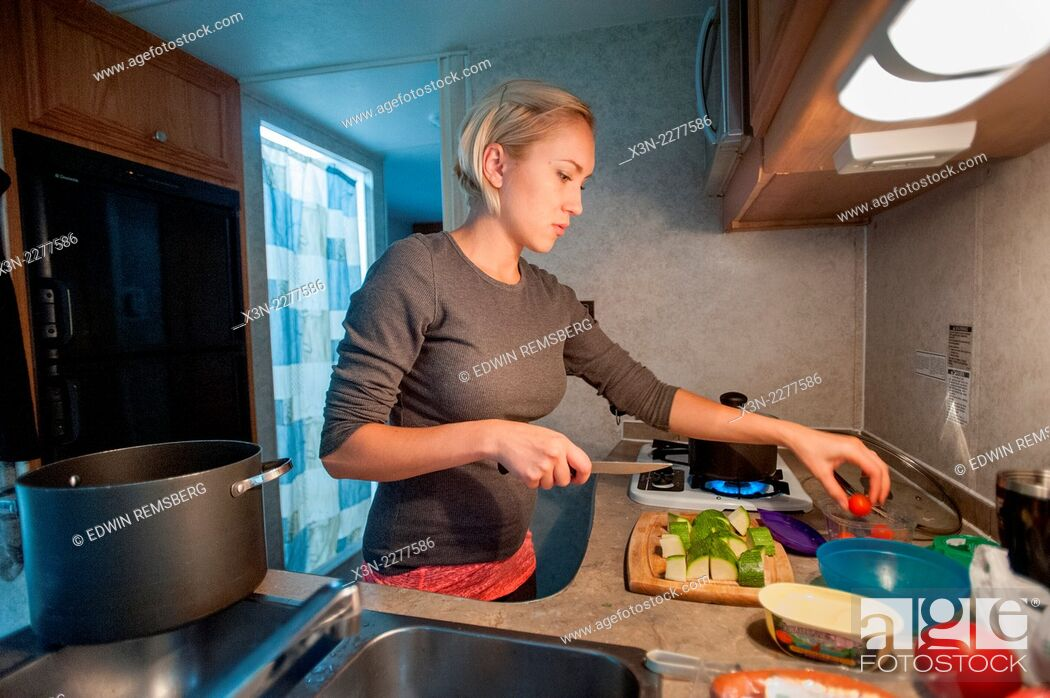 Photo de stock: Woman cooking in RV kitchen.