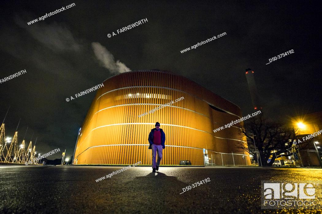 Stock Photo: Stockholm, Sweden A man walks on the grounds of the Stockholm Exergi biomass power plant in the Gardet neighborhood.