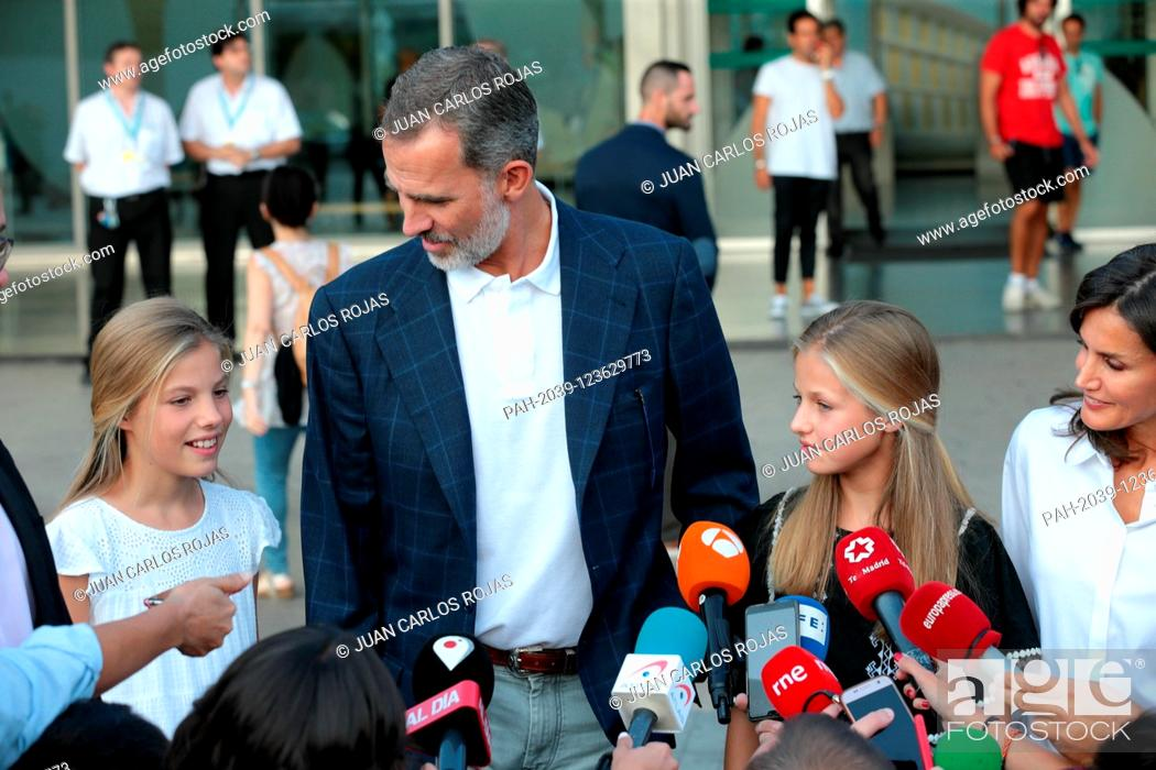 Stock Photo: Madrid Spain; 08/27 / 2019.- Felipe VI and Letizia Reyes de España speak with the press accompanied by their daughters Princess Leonor and the Infanta Sofia in.