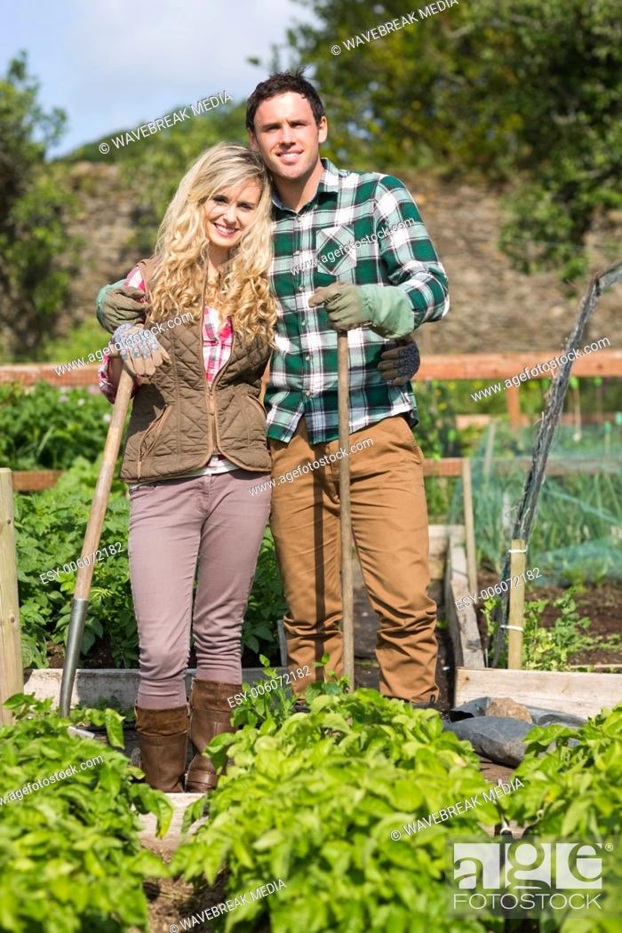 Stock Photo: Couple posing together in their garden.