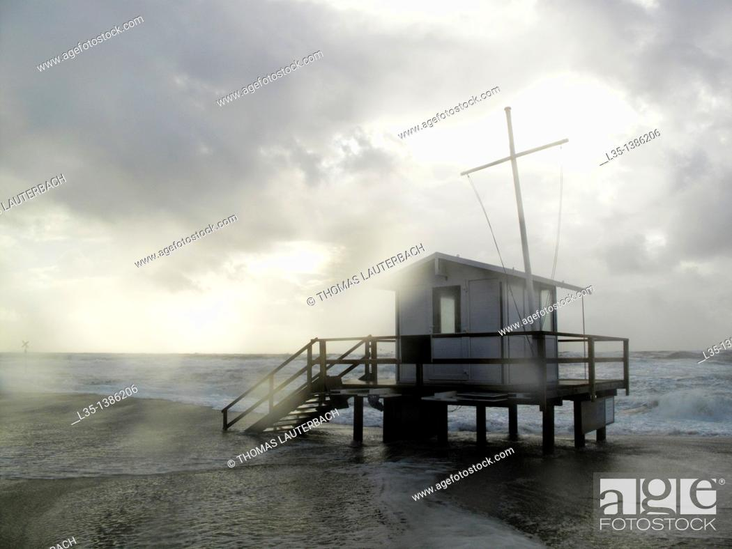 Stock Photo: Lifeguard house in bad weather and strong waves, Sylt, Germany.
