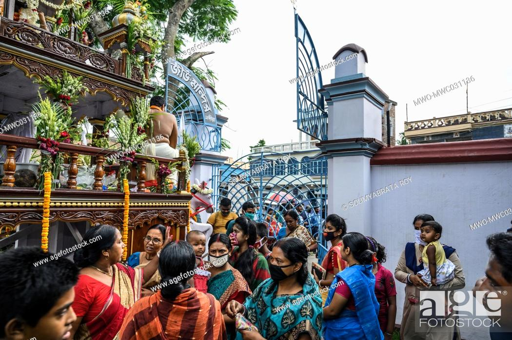 Stock Photo: Ratha Jatra also referred to as Ratha Yatra or Chariot festival, is a public procession in a chariot. Sri Sri Krishna Roy's Rath Jatra 2020 (Chariot ride of.