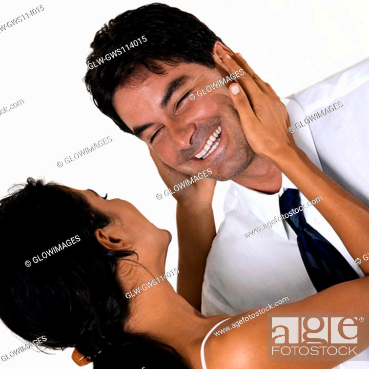 Stock Photo: Mid adult man and a young woman smiling.