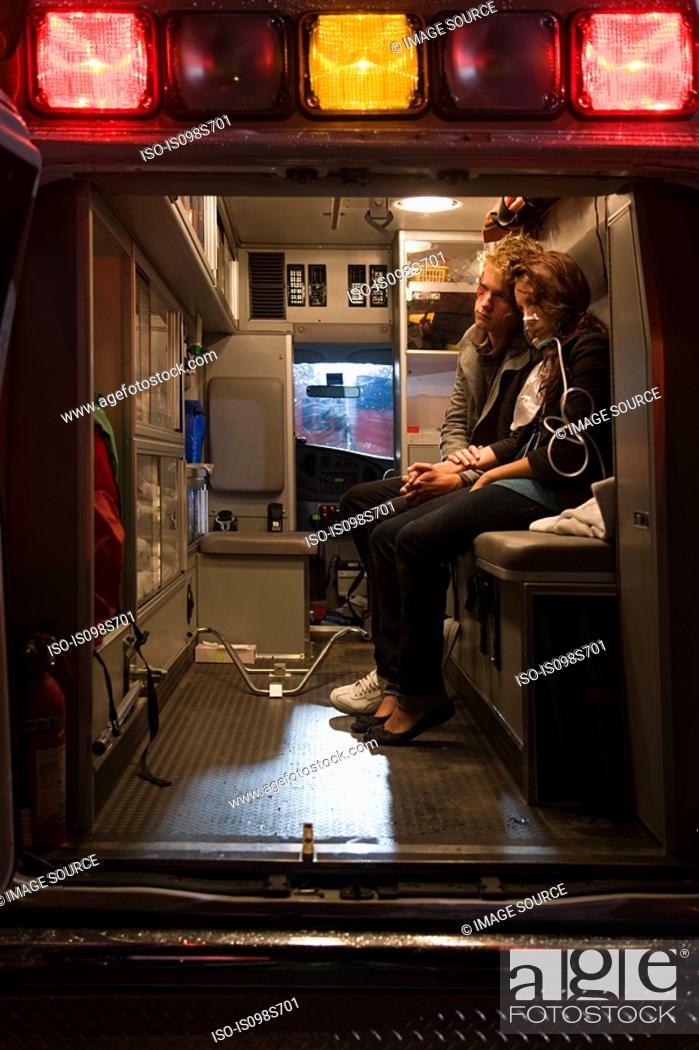 Stock Photo: Teenage couple in ambulance.