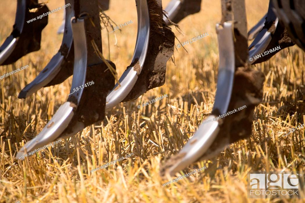 Stock Photo: Close Up Of Plough In Field Of Stubble.