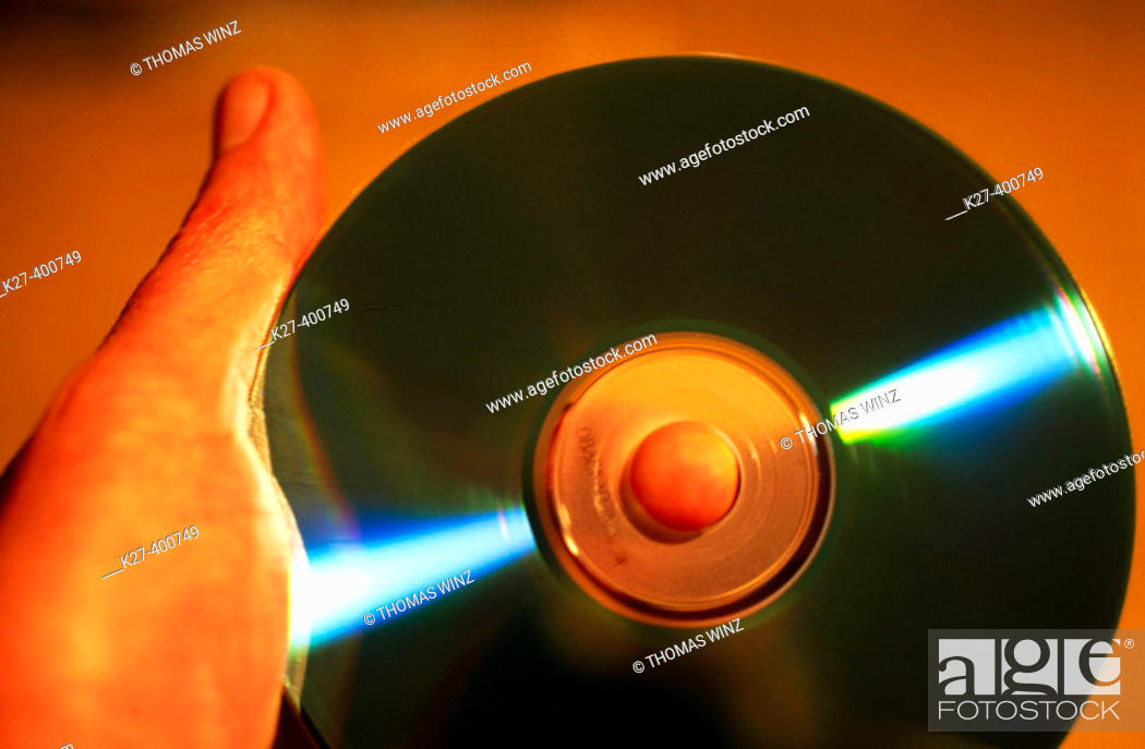 Stock Photo: Hand holding CD.
