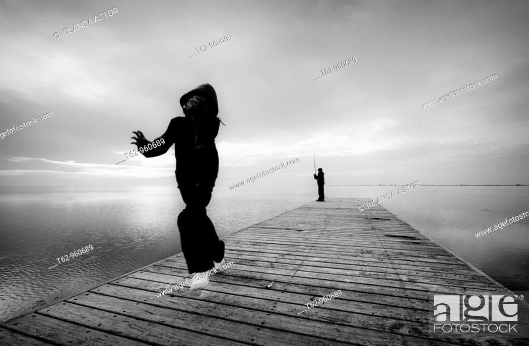 Stock Photo: Children playing and fishing on the pier  Delta del Ebro Catalonia.