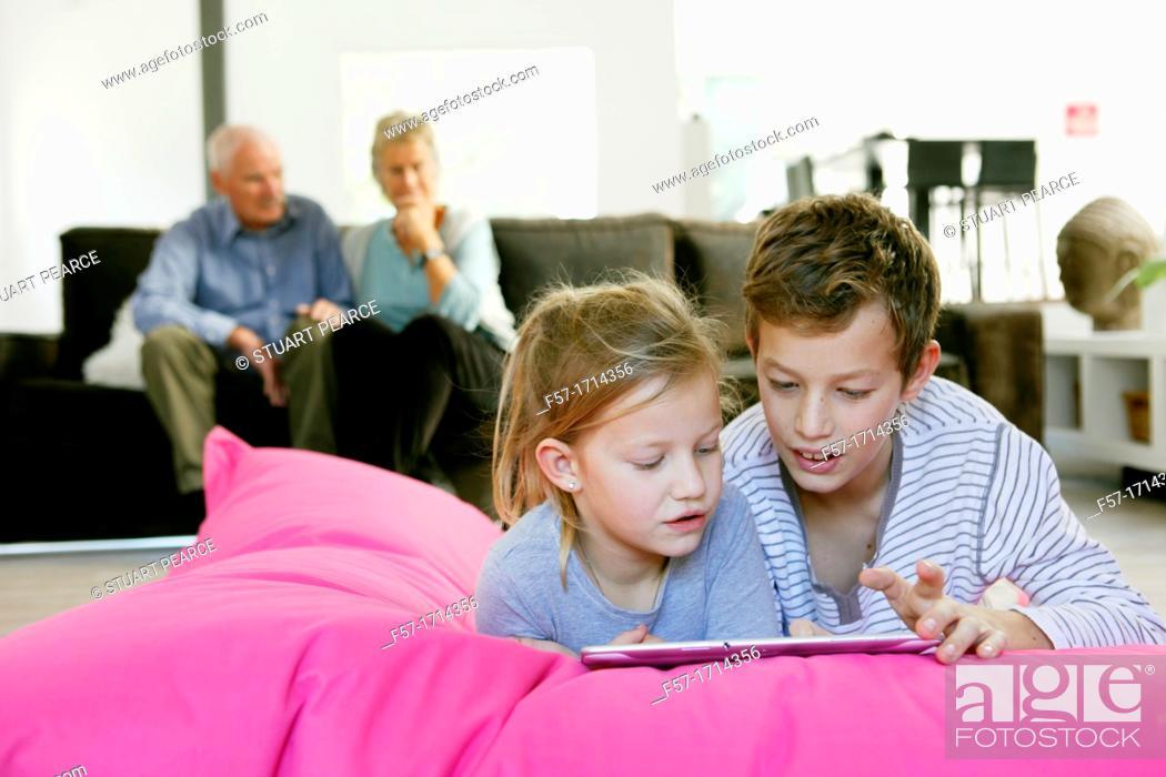 Stock Photo: Children using tablet computer.