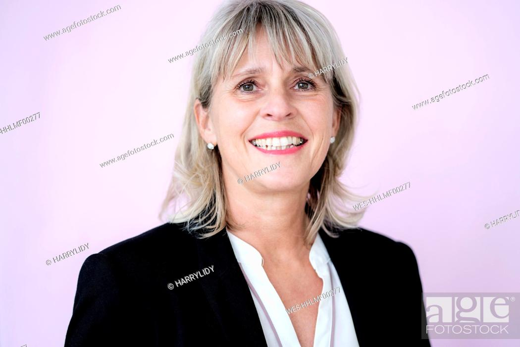 Stock Photo: Portrait of smiling mature businesswoman.
