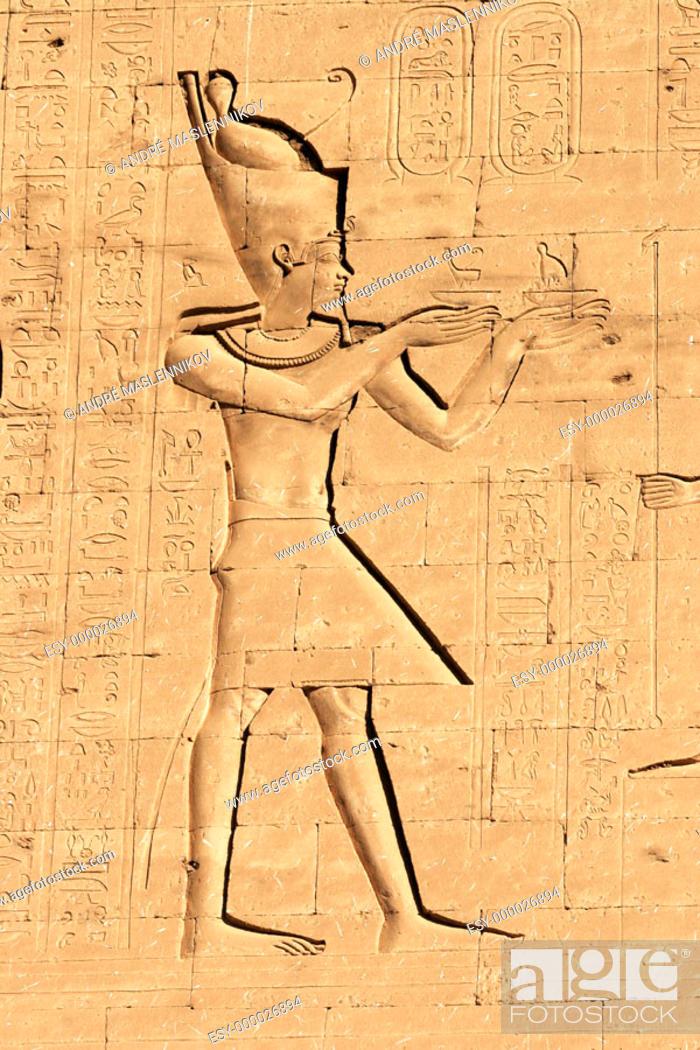 Stock Photo: Pharaoh on the wall of Horus temple in Edfu, Egypt.