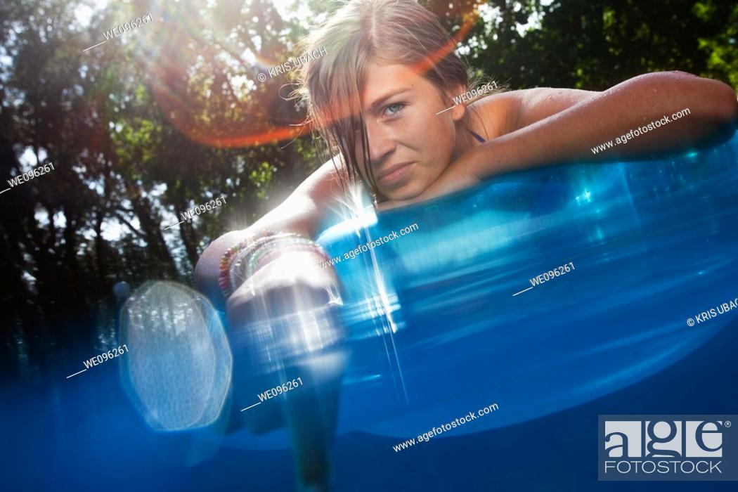 Stock Photo: Teen in a pool.