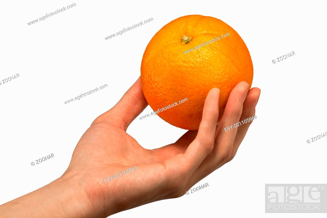 Stock Photo: Orange in man's hands.