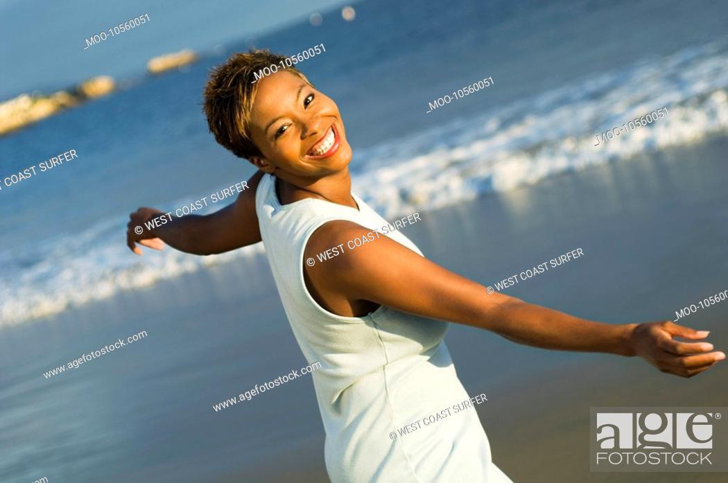 Stock Photo: Woman dancing on beach portrait.