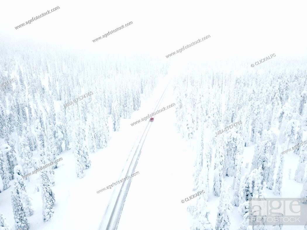 Stock Photo: Aerial view of car along the snowy road in the icy forest, Pallas-Yllastunturi National Park, Muonio, Lapland, Finland.