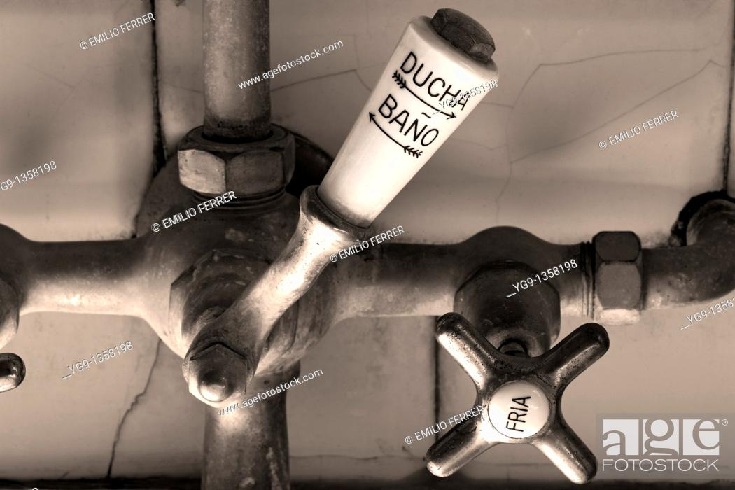 Stock Photo: Tap of Water in an old Bathtube  LLeida  Spain.