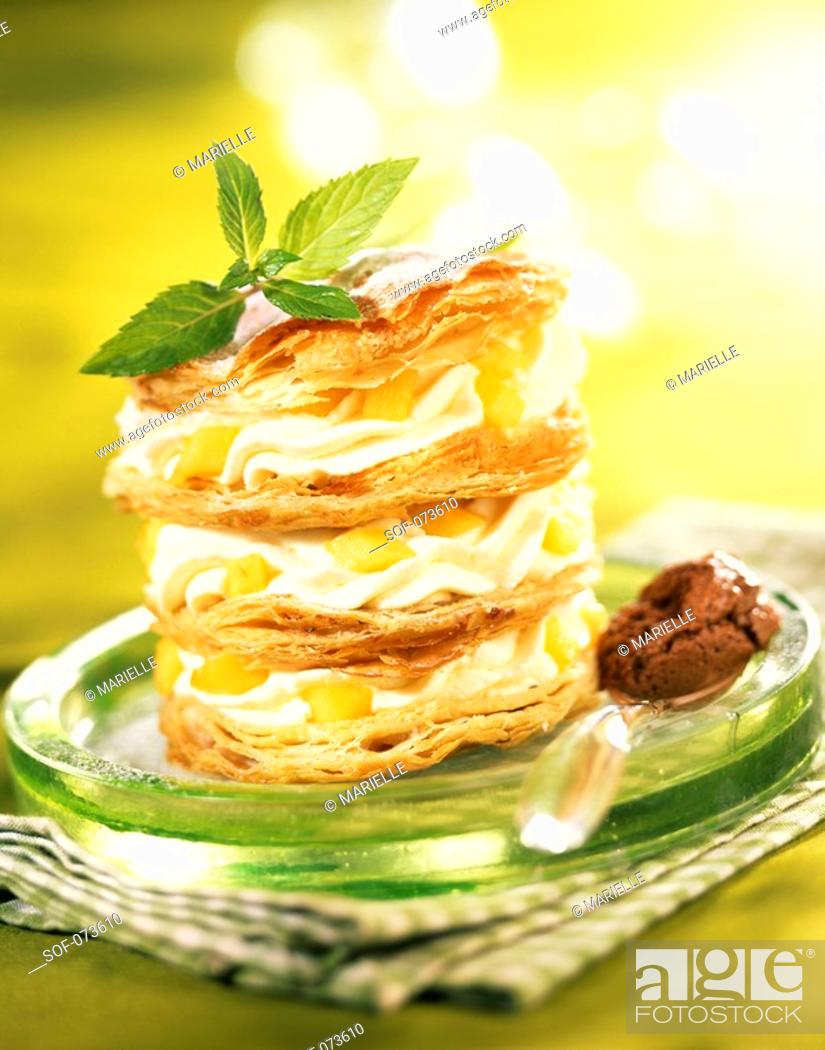 Stock Photo: mousse and peach in flaky pastry.