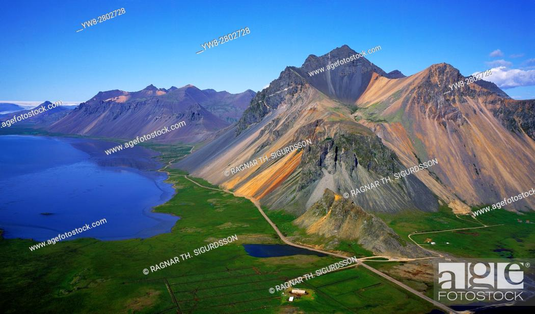 Stock Photo: Farm in Hornafjordur Fjord with Mountains, Iceland Mt. Austurhorn and Mt. Estrahorn, Eastern Iceland.
