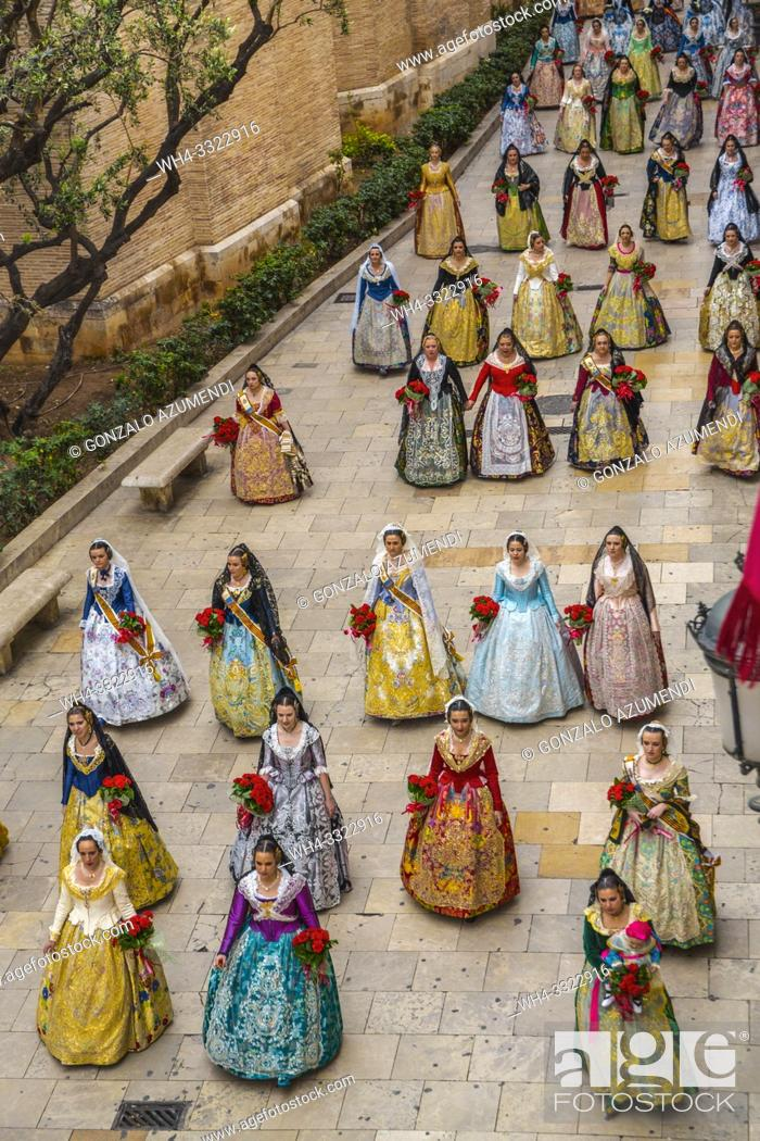 Stock Photo: Falleras. Women in traditional dress. Parade to the Plaza de la Virgin in order to make an offering of flowers to Our Lady of the Forsaken.
