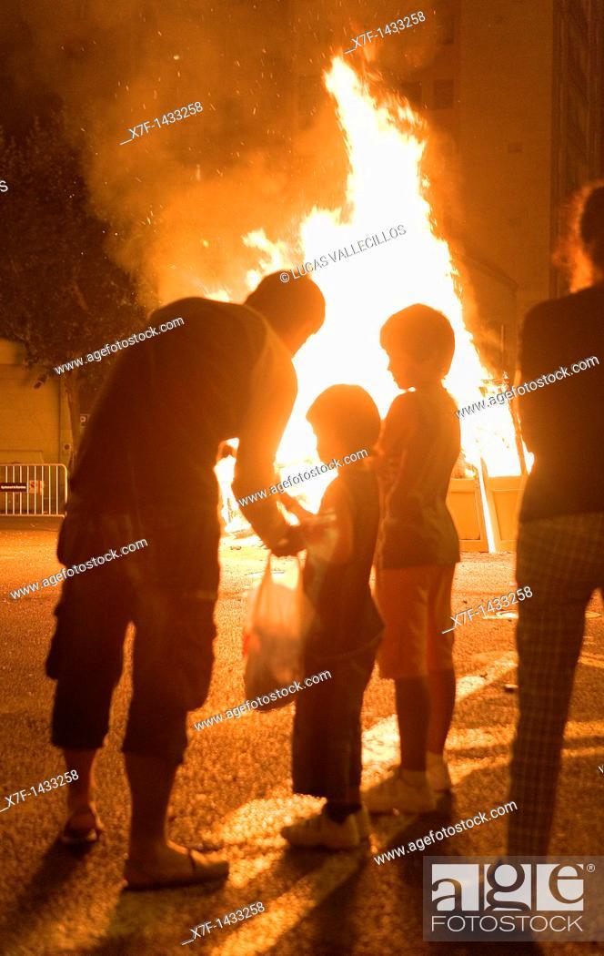 Stock Photo: `San Joan'Bonfire  Verbena de San Juan  In Diputacion street  Barcelona  Catalonia  Spain.