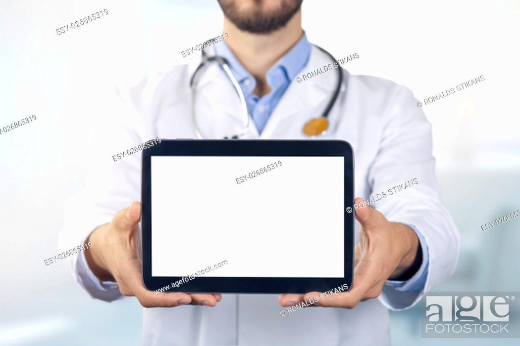 Stock Photo: doctor showing digital tablet with blank white screen.