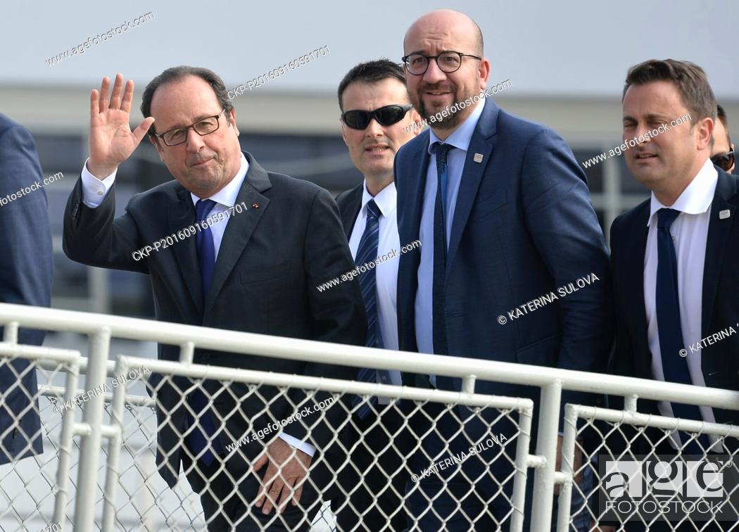Stock Photo: French President Francois Hollande (left) and Belgian Prime Minister Charles Michel (2nd right) take part in EU summit. Statesmen left for working luncheon on.