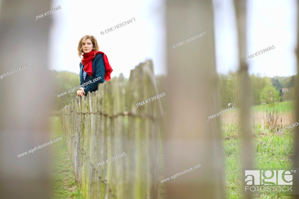 Stock Photo: Woman standing in a field.